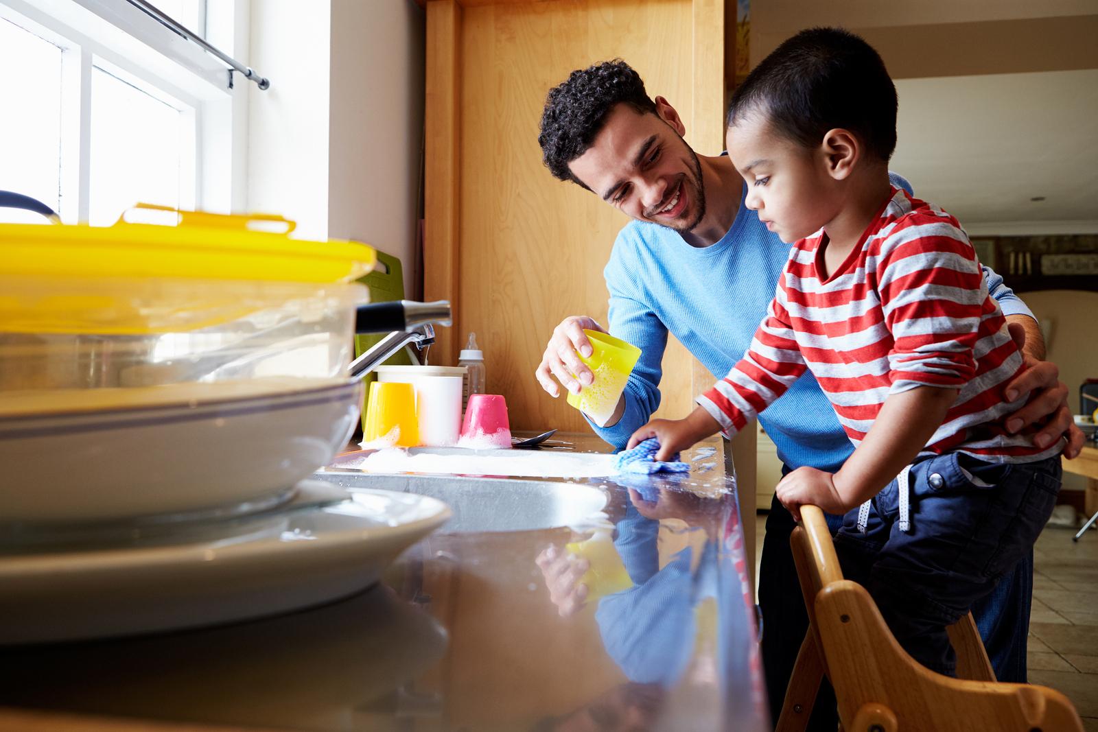 bigstock Son Helping Father To Wash Dis 117938297